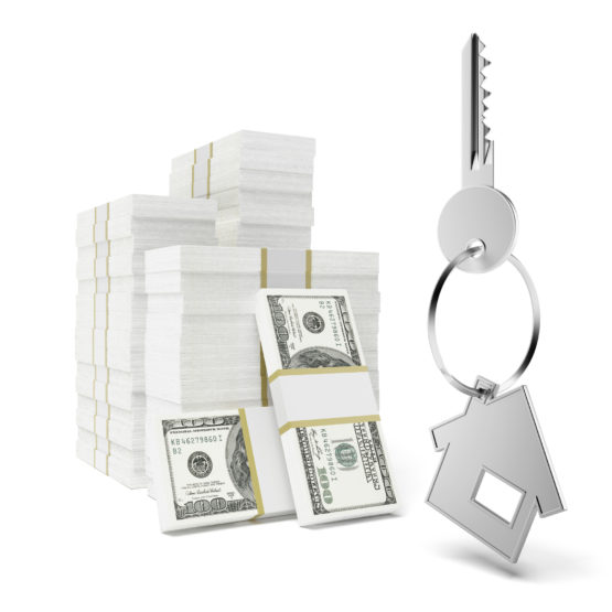 stack of cash with house keys